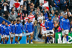 Samoa replacement Anthony Perenise walks out past The Webb Ellis Cup - Mandatory byline: Rogan Thomson/JMP - 07966 386802 - 03/10/2015 - RUGBY UNION - Stadium:mk - Milton Keynes, England - Samoa v Japan - Rugby World Cup 2015 Pool B.