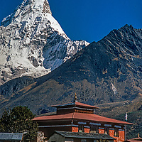 Sacred Ama Dablam rises behind Tengboche Monastery, a spiritual center for the Sherpas of Nepal. This picture was shot in 1986 before the monastery was destroyed in an 1989 electrical fire and subsequently rebuilt in a more modern form.
