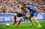 Harry Anderson of Lincoln City (26) and Alex Rodman of Shrewsbury Town (23) battle for the ball during the EFL Trophy Final match between Lincoln City and Shrewsbury Town at Wembley Stadium, London, England on 8 April 2018. Picture by Stephen Wright.