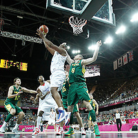 02 August 2012: France Boris Diaw goes for the reverse layup past Lithuania Darius Songaila during 82-74 Team France victory over Team Lithuania, during the men's basketball preliminary, at the Basketball Arena, in London, Great Britain.