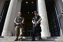 "A soldier joins a police officer outside the Ministry of Defence, London, as armed troops have been deployed to guard ""key locations"" under Operation Temperer, which is being enacted after security experts warned the Government that another terrorist attack could be imminent."