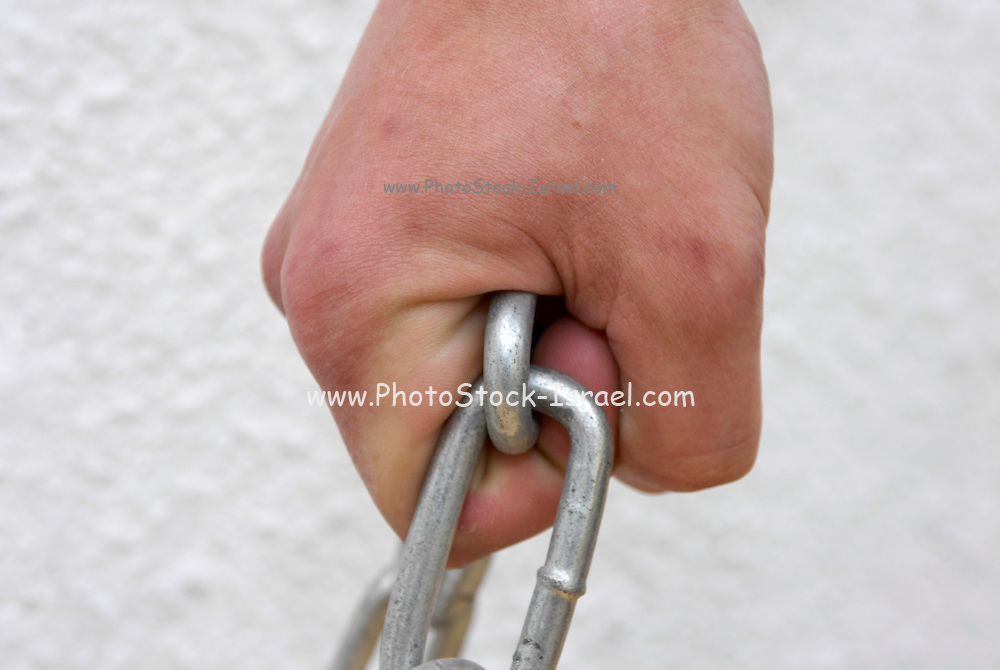 Hand pulls a chain