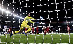 Liverpool goalkeeper Alisson Becker makes a save from Paris Saint-Germain's Marquinhos