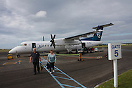 NEW PLYMOUTH, New Zealand - 16 January 2010 - Passengers disembark and luggage is unloaded from an Air New Zealand Bombadier Q300 at New Plymouth's airport..Picture: Giordano Stolley/Allied Picture Press