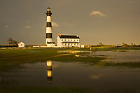 NC01300-00...NORTH CAROLINA - The sun came out in the late afternoon after a very wet day at Bodie Island Lighthouse reflecting in a puddle; part of Cape Hatteras National Seashore.