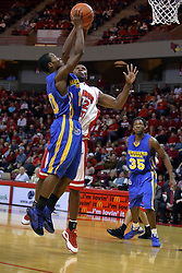 06 December 2008: Dinma Odiakosa blocks a shot by Robert Murry but gets called for a hacking infraction during a game where the  Illinois State University Redbirds extended their record to 9-0 with a 76-70 win over the Eagles of Morehead State on Doug Collins Court inside Redbird Arena on the campus of Illinois State University in Normal Illinois