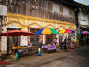 22 DECEMBER 2018 - CHANTABURI, THAILAND: Food vendors set up their stands in front of a traditional shop house in Chantaburi. Chantaburi is the capital city of Chantaburi province on the Chantaburi River. Because of its relatively well preserved tradition architecture and internationally famous gem market, Chantaburi is a popular weekend destination for Thai tourists.         PHOTO BY JACK KURTZ