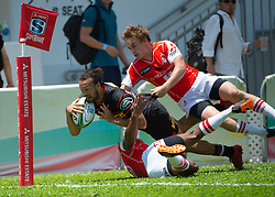 May 19, 2018 - Hong Kong, Hong Kong, China - Outside centre Johannes Engelbrecht (13) of the Stormers scores the first match try. Hayden Parker (R) races to prevent the try.Japanese team Sunwolves win 26-23 over South Africa's Stormers in Rugby Super League's Hong Kong debut. Mong Kok Stadium, Hong Kong . Photo Jayne Russell (Credit Image: © Jayne Russell via ZUMA Wire)