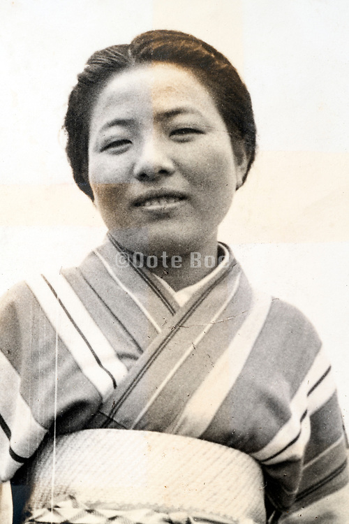 young adult woman in traditional kimono clothing portrait ca 1950s Japan