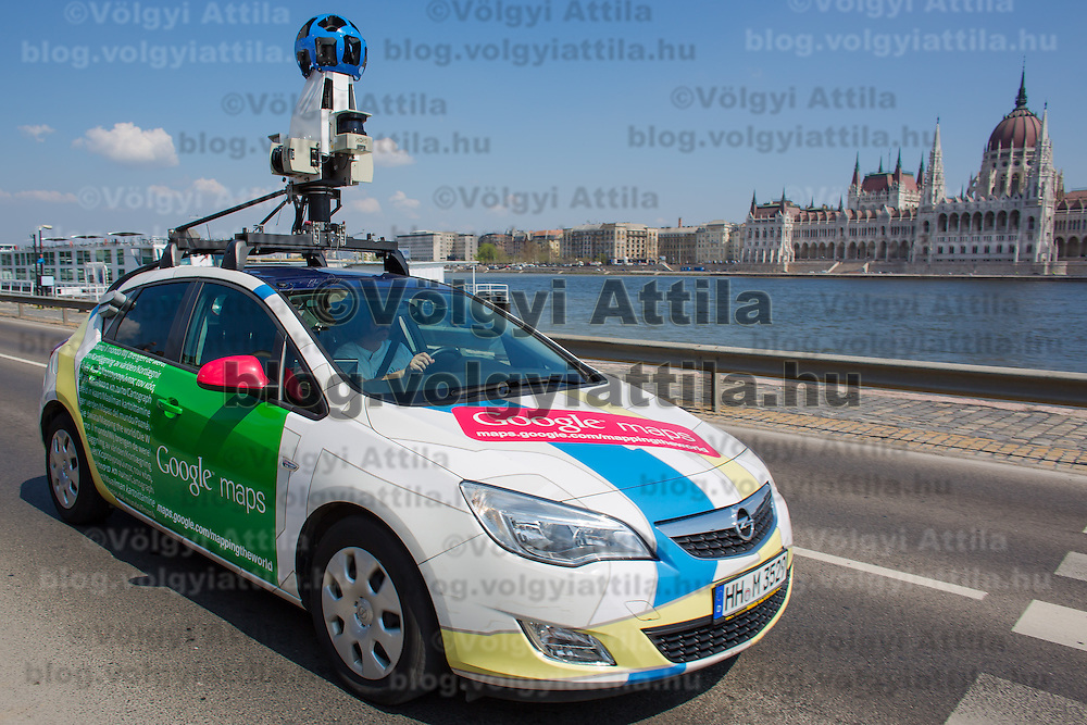 Special car recording photos for the Google Street View service is seen in traffic in front of the Hungarian Parliament heading to a press conference on the Hungarian launch of Google Street View in Budapest, Hungary on April 23, 2013. ATTILA VOLGYI