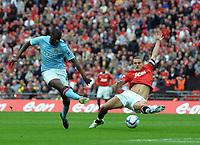 Wembley Stadium Manchester City  v Manchester United FA Cup Semi Final 16/04/2011<br />Yaya Toure  (Manchester City) beats Nemanja Vidic (Manchester United) to score opening goal<br />Photo: Robin Parker Fotosports International