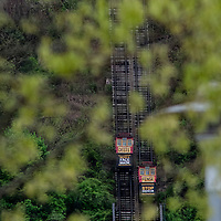 The Duquesne Incline climbs Mount Washington with a message to wear mask to slow the progress of Covid 19 on Tuesday, May 5, 2020 in Pittsburgh .   Photo by Archie Carpenter/UPI