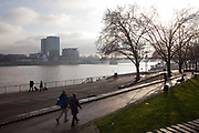 People walking along Banks of the Rhine on a misty day, Cologne.