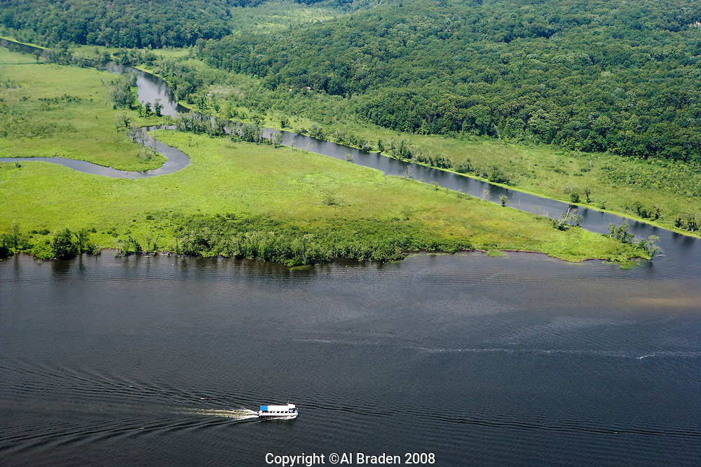 Aerial of Selden Creek, small inlet (looking west) along Selden Island along the Connecticut River, Lyme, CT. RiverQuest cruise boat in foreground.