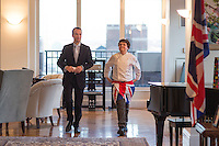 NEW YORK - April 10, 2014 - 13 year old Alexander Weiss, right, was the winner of Master Chef Junior on TV. He goes to the British International School in New York and was invited by the British Consul General, Danny Lopez, left, to prepare a British themed dinner at the consul's residence. <br /> (Photo by Robert Caplin)