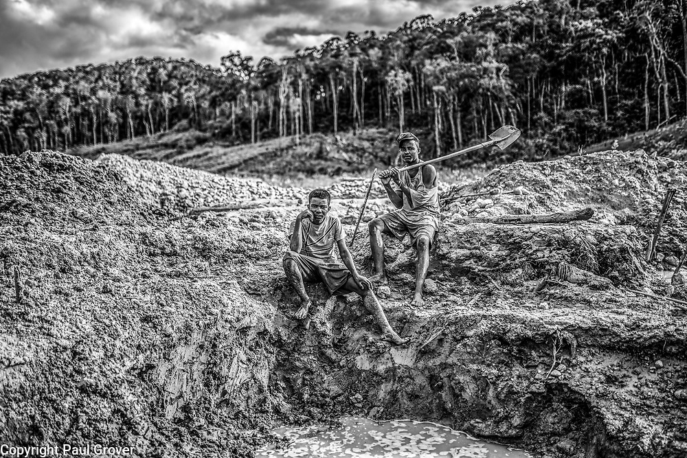Fea0093883. DT News.Tananarive a mining village near AMBATONDRAZAKA,The Ankeniheny-Zahamena Corridor, Madagascar.Pic Shows Two young miners from  Madagascar looking for sapphires in the village of Tananarive