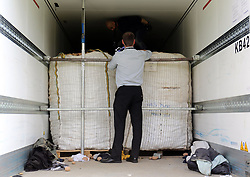 File photo dated 16/06/15 of police searching a lorry at Peterborough services in Cambridgeshire for migrants, as ten fines are issued to hauliers every day after migrants are found hiding in lorries, new figures show.
