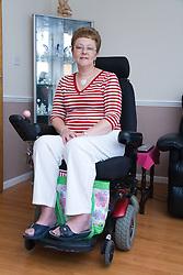 Older woman wheelchair user smiling;