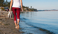 The sun is warm on a clear sunny day at Cordova Beach, Victoria, BC as Taylor walks along the sand.