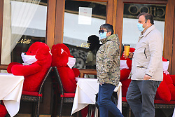 People with face mask walk front of the Italian restaurant Nello on Madison Avenue during the Covid-19 pandemic in New York City, NY, USA on April 22, 2020. The Big Apple neared a painful milestone Wednesday as the death toll from the coronavirus outbreak that has ravaged the five boroughs approached 15,000. The pandemic has claimed the lives of 14,996 New Yorkers, with new 569 fatalities reported in the most recent 24-hour period, according to data from the city's Department of Health. Photo by Charles Guerin/ABACAPRESS.COM