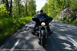 Ola Eriksson riding his 2011 Harley-Davidson Street Glide on a Twin Club ride out from the club house in Norrtälje after their annual Custom Bike Show. Sweden. Sunday, June 2, 2019. Photography ©2019 Michael Lichter.
