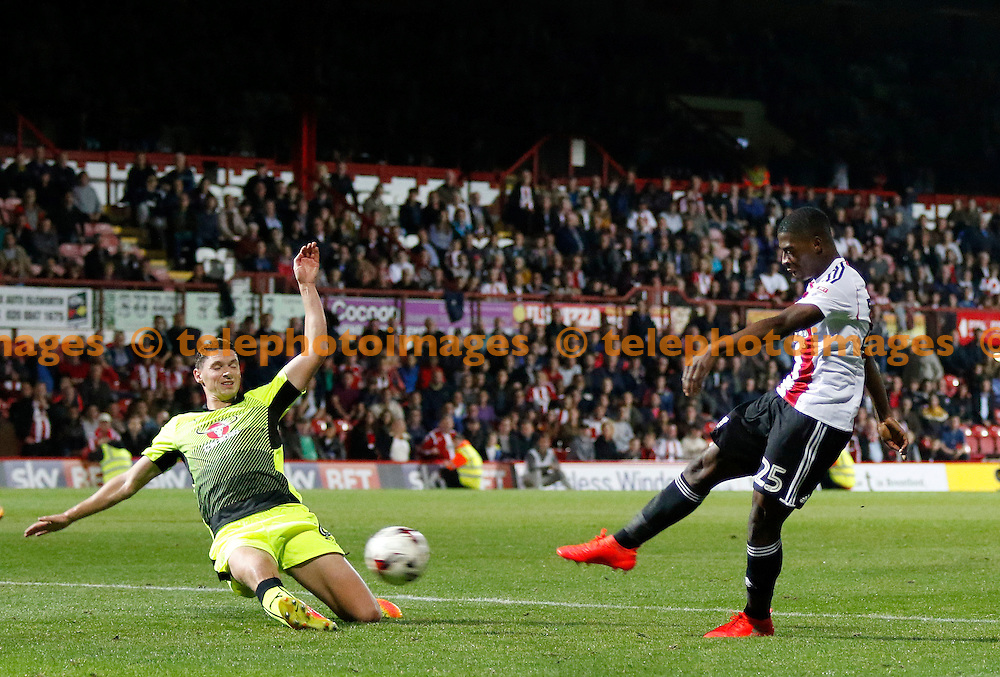 Brentford's Sullay Kaikai gets a shot off during the Sky Bet Championship match between Brentford and Reading at Griffin Park in London. September 27, 2016.<br /> Carlton Myrie / Telephoto Images<br /> +44 7967 642437