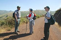 Coastwalk Team Members Talking To National Park Ranger On Coastal Trail