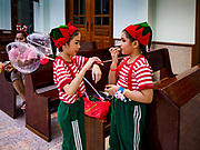 "23 DECEMBER 2018 - CHANTABURI, THAILAND: Girls playing elves in the Christmas pageant get ready for the show at the Cathedral of the Immaculate Conception's Christmas Fair in Chantaburi. Cathedral of the Immaculate Conception is holding its annual Christmas festival, this year called ""Sweet Christmas @ Chantaburi 2018"". The Cathedral is the largest Catholic church in Thailand and was founded more than 300 years ago by Vietnamese Catholics who settled in Thailand, then Siam.  PHOTO BY JACK KURTZ"