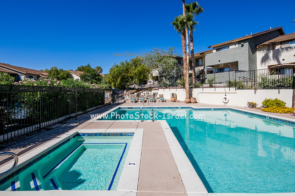 Pool and sunbathing area Photographed at Sunset Winds Apartments Henderson, NV, USA
