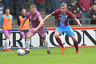 Scunthorpe United midfielder Matthew Lund (7)  and Rochdale midfielder Andy Cannon (27) during the EFL Sky Bet League 1 match between Scunthorpe United and Rochdale at Glanford Park, Scunthorpe, England on 8 September 2018. Photo Ian Lyall