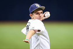August 9, 2017 - St. Petersburg, Florida, U.S. - WILL VRAGOVIC   |   Times.One handed pitcher Kevin Ewing throws the ceremonial first pitch of the game between the Boston Red Sox and the Tampa Bay Rays at Tropicana Field in St. Petersburg, Fla. on Wednesday, August 9, 2017. (Credit Image: © Will Vragovic/Tampa Bay Times via ZUMA Wire)