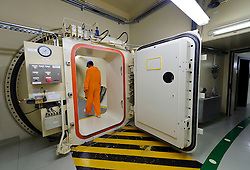 An RWE employee exits the reactor chamber, a spherical shaped building, at the RWE nuclear power plant, in Lingen, Germany, on Tuesday, Sept. 6, 2011. (Photo © Jock Fistick)