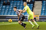 Millwall midfielder Ben Thompson (8), Peterborough United forward Marcus Maddison (11) during the EFL Sky Bet League 1 match between Millwall and Peterborough United at The Den, London, England on 28 February 2017. Photo by Sebastian Frej.