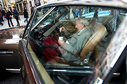 © Licensed to London News Pictures.02/11/2013. London, UK. A veteran car owner drinks tea in his car at the Regent Street Motor Show that is the largest free motor show in the UK. More then 300 vehicles are displayed, from classic automobiles of the Victorian age right up to the very latest 'super' cars of today. Photo credit : Peter Kollanyi/LNP