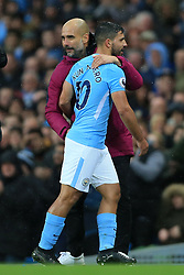 21st October 2017 - Premier League - Manchester City v Burnley - Man City manager Pep Guardiola hugs Sergio Aguero of Man City after substituting him - Photo: Simon Stacpoole / Offside.