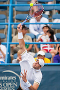 USA's John Isner serves to Russia's Dmitry Tursunov during their men's semifinals singles match at the Citi Open ATP tennis tournament in Washington, DC, USA, 3 Aug 2013.  Isner won the match 6-7, 6-3, 6-4 to advance to the final on Sunday.