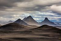 Cones of volcanic palagonite dot the black <br /> wastes north of the glacier Vatnajökull.