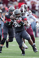 LITTLE ROCK, ARKANSAS - NOVEMBER 23:  Kiero Small #36 of the Arkansas Razorbacks is tackled by Nickoe Whitley #1 of the Mississippi State Bulldogs at War Memorial Stadium on November 23, 2013 in Little Rock, Arkansas.  The Bulldogs defeated the Razorbacks 24-17.  (Photo by Wesley Hitt/Getty Images) *** Local Caption *** Kiero Small; Nickoe Whitley
