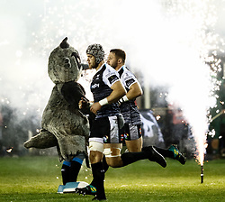Dan Lydiate of Ospreys with team-mate  Scott Otten take to the field<br /> <br /> Photographer Simon King/Replay Images<br /> <br /> Guinness PRO14 Round 7 - Ospreys v Connacht - Friday 26th October 2018 - The Brewery Field - Bridgend<br /> <br /> World Copyright © Replay Images . All rights reserved. info@replayimages.co.uk - http://replayimages.co.uk