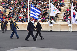 October 31, 2017 - Athens, Attiki, Greece - President of Hellenic Republic Prokopis Pavlopoulos (right) is accompanied by the President of the Hellenic Olympic Committee Spyros Capralos (left). The Handover Ceremony of the Olympic Flame for Winter Games PYEONGCHANG 2018, took place today in Panathenaic Stadium in the presence of the President of Hellenic Republic Prokopis Pavlopoulos. (Credit Image: © Dimitrios Karvountzis/Pacific Press via ZUMA Wire)