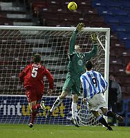 Fotball<br /> England 2004/2005<br /> Foto: SBI/Digitalsport<br /> NORWAY ONLY<br /> <br /> Huddersfield Town v Bristol City<br /> Coca-Cola League 1<br /> 03/01/2005<br /> <br /> Huddersfield's Pavel Abbott lifts the ball over Bristol keeper Steve Phillips for Town's second goal