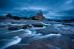 Stock photo of an early morning storm rolling in at Eagle Rock and the Llano River in the Texas Hill Country