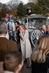 © Licensed to London News Pictures . 30/10/2018. Accrington , UK . The actress KATE WINSLET enters the crematorium with her husband EDWARD SMITH (aka NED ROCKNROLL ) at the start of the service . The funeral of Gemma Nuttall at Accrington Crematorium . Gemma died of cancer despite initially seeing off the disease after radical immunotherapy treatment in Germany , paid for with the fundraising support of actress Kate Winslet , who read of Gemma's plight on a crowdfunding website shortly after she lost her own mother to cancer . Permission to photograph given by Gemma's mother , Helen Sproates . Photo credit : Joel Goodman/LNP