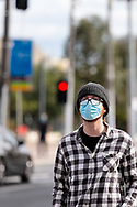 MELBOURNE, VIC - SEPTEMBER 20: A man wearing a mask and glasses walks by during a series of pop up Freedom protests on September 20, 2020 in Melbourne, Australia. Freedom protests are being held in Melbourne every Saturday and Sunday in response to the governments COVID-19 restrictions and continuing removal of liberties despite new cases being on the decline. Victoria recorded a further 14 new cases overnight along with 7 deaths. (Photo by Dave Hewison/Speed Media)