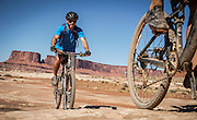 SHOT 10/15/16 2:14:25 PM - Mountain biking the White Rim Trail. The White Rim is a mountain biking trip in Canyonlands National Park just outside of Moab, Utah. The White Rim Road is a 71.2-mile-long unpaved four-wheel drive road that traverses the top of the White Rim Sandstone formation below the Island in the Sky mesa of Canyonlands National Park in southern Utah in the United States. The road was constructed in the 1950s by the Atomic Energy Commission to provide access for individual prospectors intent on mining uranium deposits for use in nuclear weapons production during the Cold War. Four-wheel drive vehicles and mountain bikes are the most common modes of transport though horseback riding and hiking are also permitted.<br /> (Photo by Marc Piscotty / © 2016)