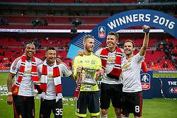 L-R Ashley Young, Goalscorer Jesse Lingard, David De Gea, Michael Carrick and Goalscorer Juan Mata of Manchester United celebrate after winning the FA Cup with a 1-2 victory after the game went to extra time - Mandatory byline: Rogan Thomson/JMP - 21/05/2016 - FOOTBALL - Wembley Stadium - London, England - Crystal Palace v Manchester United - FA Cup Final.