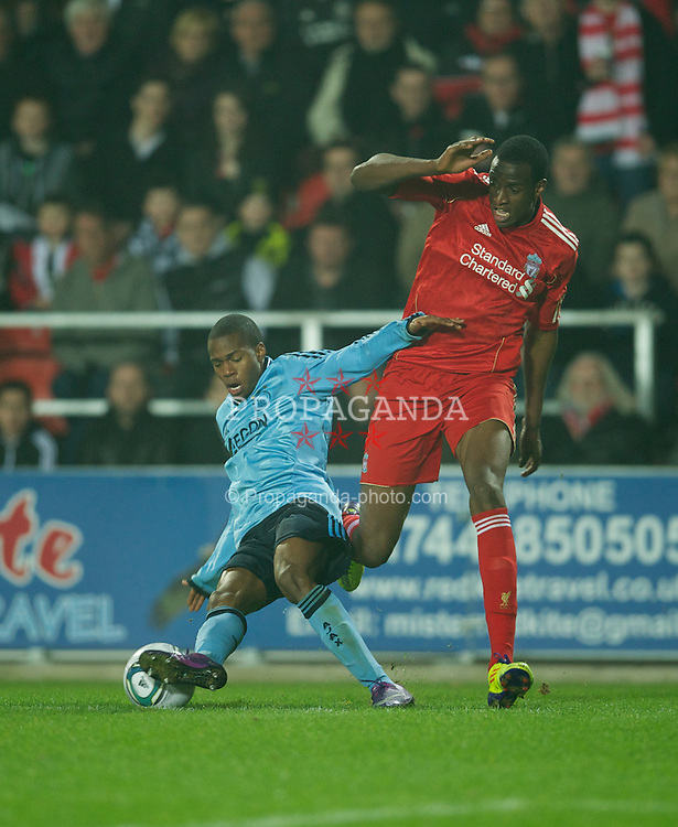 ST HELENS, ENGLAND - Wednesday, March 14, 2012: Liverpool's Michael Ngoo in action against AFC Ajax's Ruben Ligeon during the NextGen Series Semi-Final match at Langtree Park. (Pic by David Rawcliffe/Propaganda)