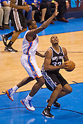 June 2, 2012; Oklahoma City, OK, USA; San Antonio Spurs center Boris Diaw (33) looks to take a shot under pressure from Oklahoma City Thunder forward Serge Ibaka (9) during a playoff game  at Chesapeake Energy Arena.  Thunder defeated the Spurs 109-103 Mandatory Credit: Beth Hall-US PRESSWIRE