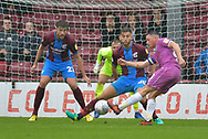 Rochdale forward Ian Henderson (40) takes a close range shot at goal during the EFL Sky Bet League 1 match between Scunthorpe United and Rochdale at Glanford Park, Scunthorpe, England on 8 September 2018. Photo Ian Lyall