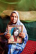 Zeibou a widow with a photo of her husband, Gulanjahn. He was killed during the Russian occupation 1979 (December)-1989 (February)